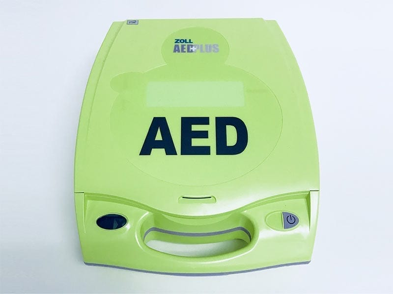 an image of a lime green AED case